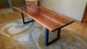walnut table with trestle base